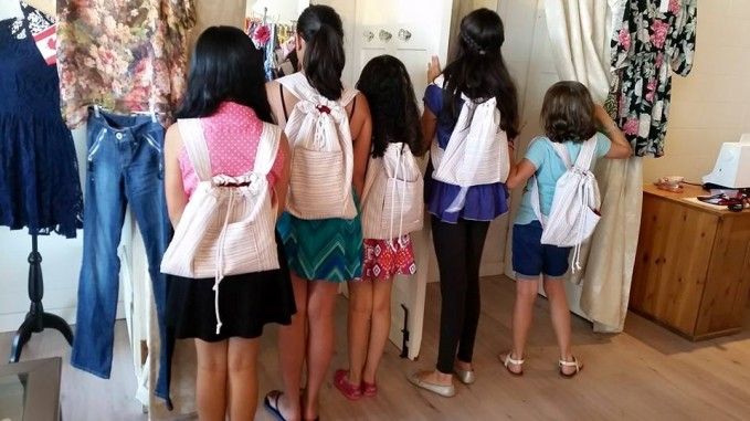 kids modeling their homemade backpacks (look ma, no princesses!)
